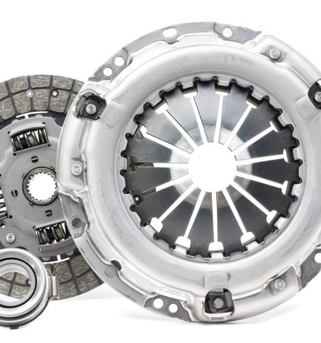 A new set of replacement automotive clutch on a white background. Disc and clutch basket with release bearing